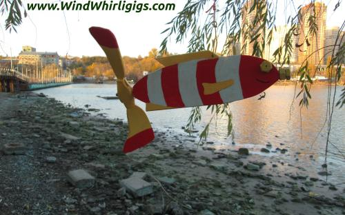 How to make a garden decor Red Striped Fish whirligig. Outdoor view.