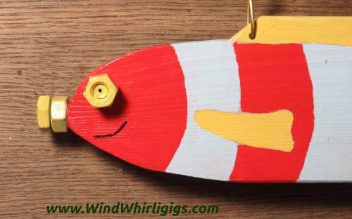 How to make a garden decor Red Striped Fish whirligig. Close-up view.