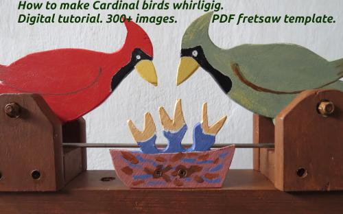 How to make Cardinal birds whirligig. Male and female at the nest. Close-up view.