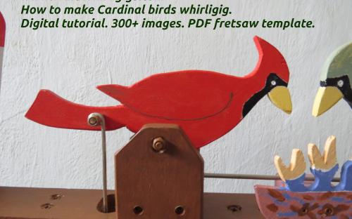 How to make Cardinal birds whirligig. Male at the nest. Close-up view.