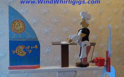"Wind-driven wooden whirligig ""Rolling out a Pizza"""