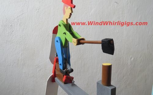 Side view portrait of woodchopper man whirligig