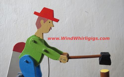 Weather vane in the form of a lumberjack with an ax. Wood Chopper Handmade Wooden Whirligig.