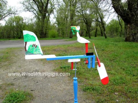 "Wind-driven wooden whirligig ""Crane and a frog - never give up"""