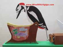 Whirligig - Woodpecker disturbes a bug in a stump. Wind-driven whirligig.