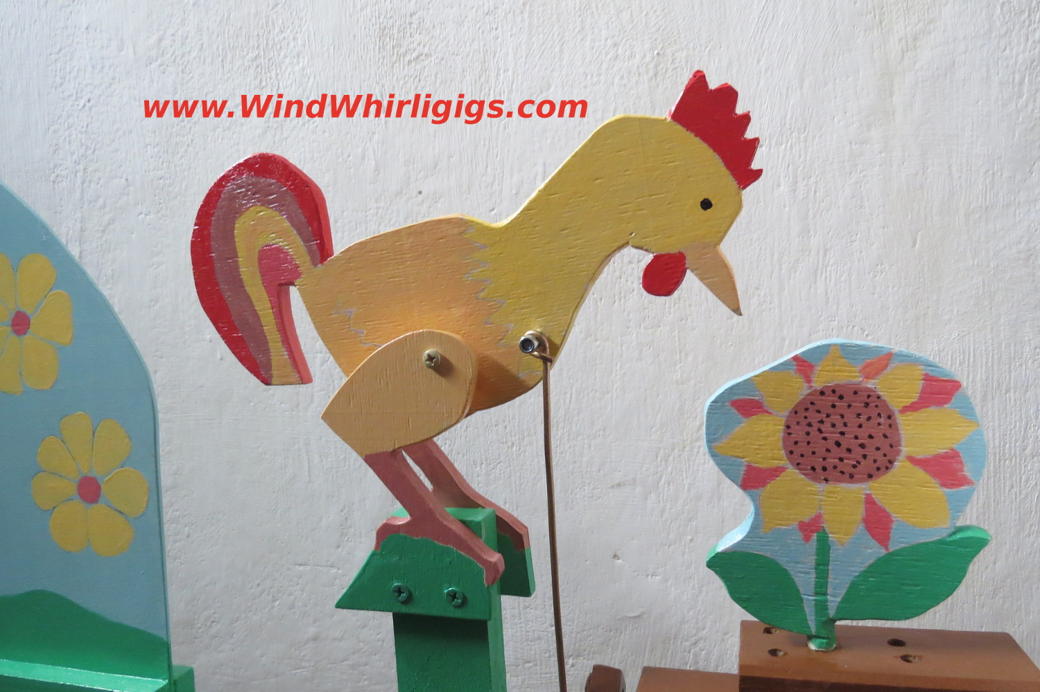 Rooster Whirligig. Cockerel pecks a sunflower. Wind-driven whirligig for sale.